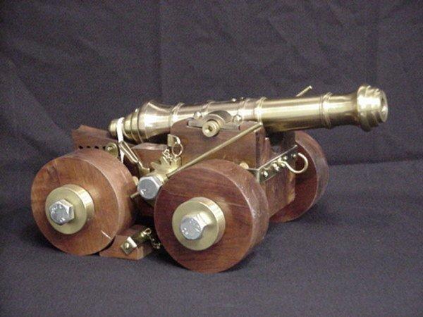 1502: Decorative miniature cannon brass/wood
