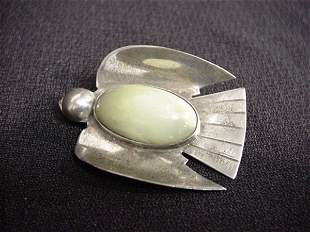 Sterling Indian bird pin with light green stone