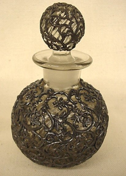 """2022: Perfume decanter with heavy """"silver"""" overlay"""