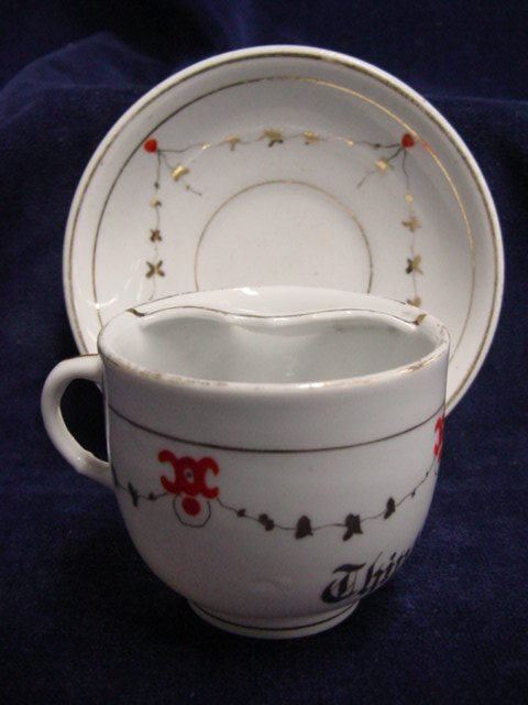 7015: Mustache cup & saucer, Think of Me