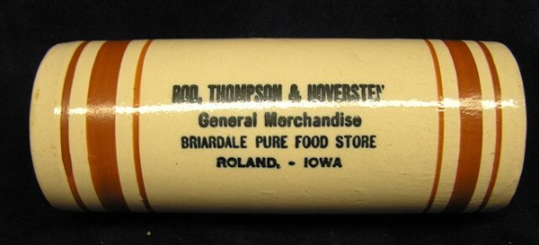 7091: Advertising crock rolling pin from Roland Iowa