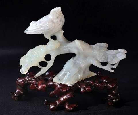 Bird in a white jade