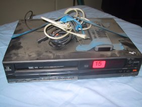 15: Hitachi VHS front loading video tape reco