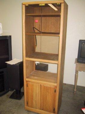 16: Wood entertainment center w/ glass doors