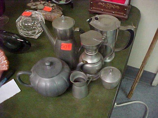 501: Four metallic teapots, one creamer and o