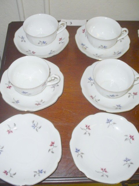 613: 6 saucers, 4 cups.  Red, blue & gray transferware,