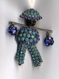 1204: Hobe Asian figure pin