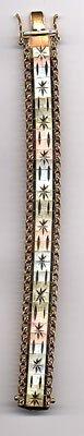 1208: Tri-color 14k gold bracelet