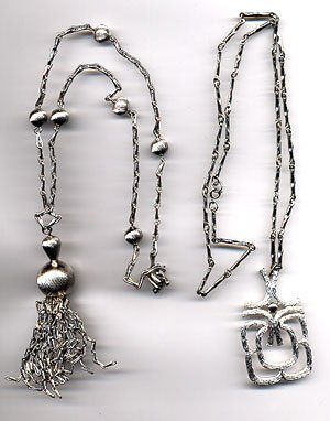 1219: 2 Silver toned necklaces