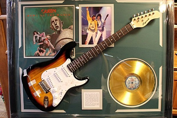 Autographed Queen Guitar with Gold Record and Album