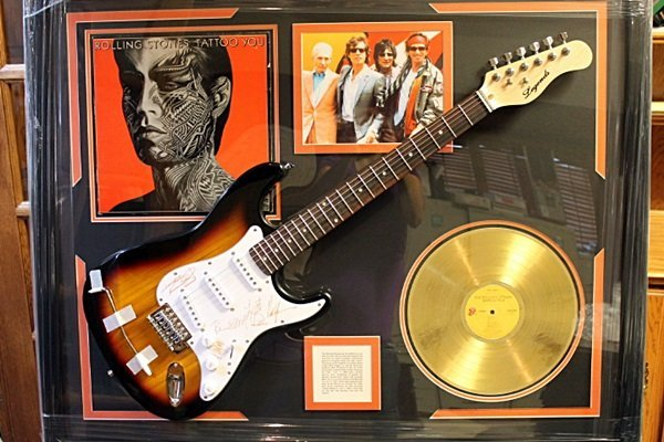 Autographed Rolling Stones Guitar with Gold RecorD and