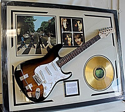The Beatles Signed Guitar with awesome collectables!