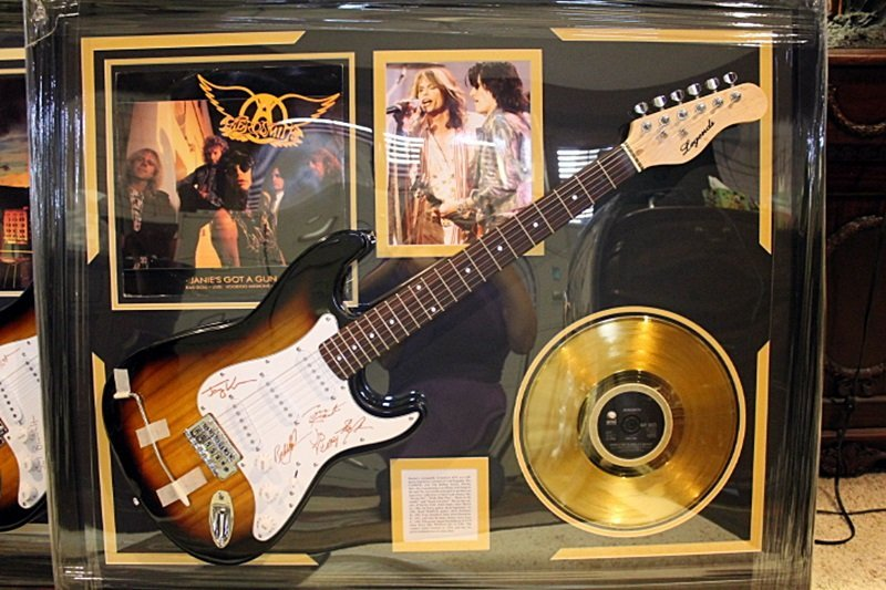 Autographed Aerosmith Guitar with Gold Record and Album