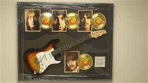 The Beatles Autographed Guitar and Four Gold 45s