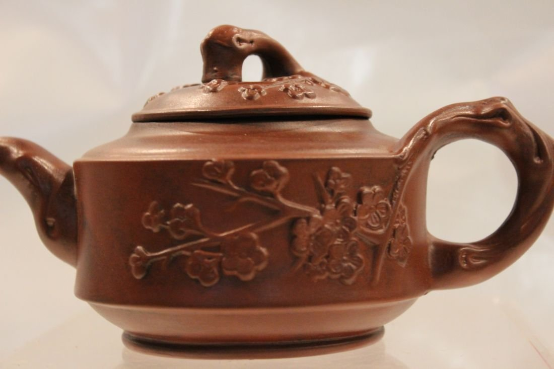 I-Hsing teapot with Plum Blossoms