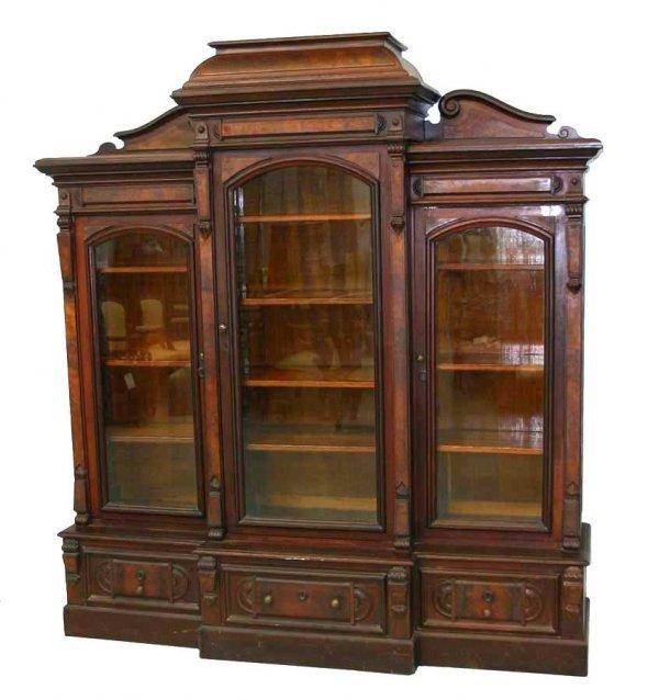 18: American Renaissance Walnut Three Door Bookcase. Ea