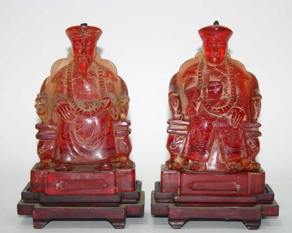 220: Pair of Oriental Buddha Figures on Mahogany Stands