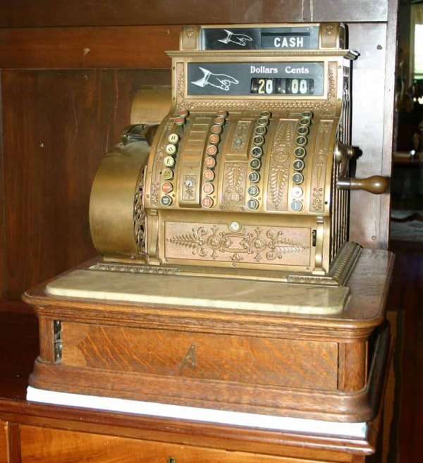 17: Antique Brass National Cash Register on Oak Base