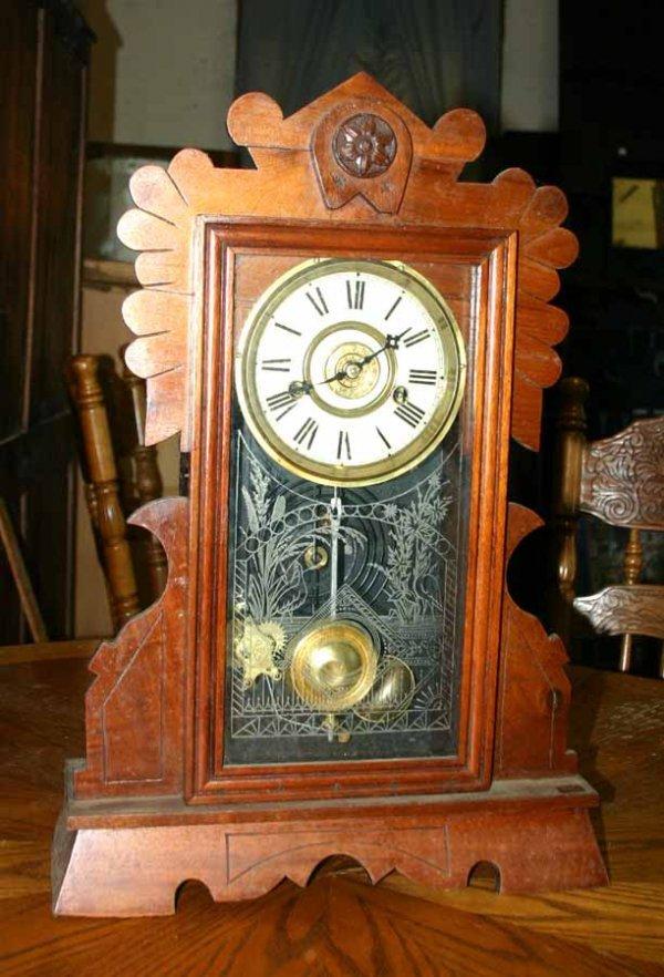 1002: Antique Carved Wooden Mantle Clock