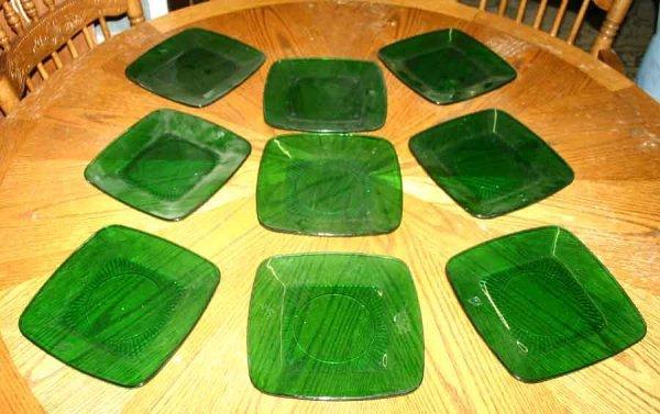 1006: Nine Green Glass Square Plates