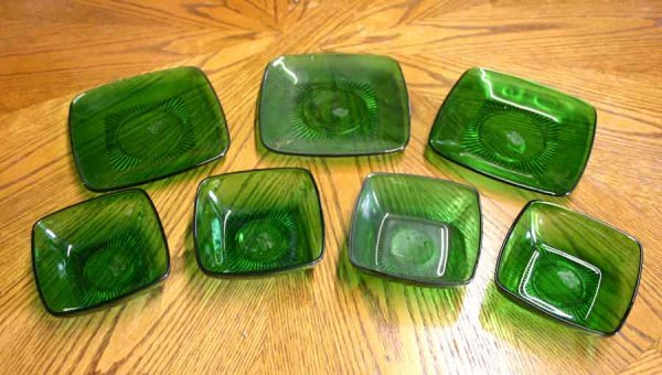 1007: Seven Pieces Green Glass Bowls & Plates