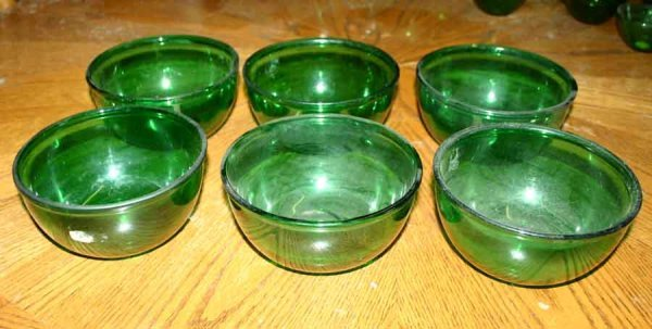 1008: Six Green Glass Bowls
