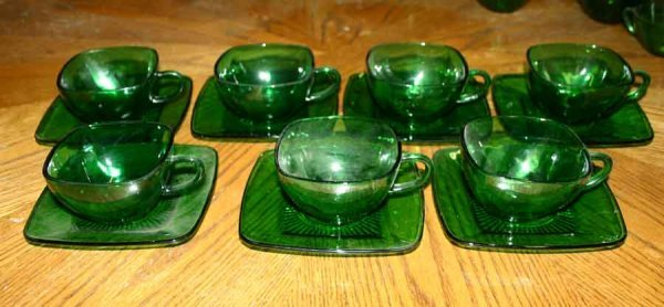 1009: Seven Green Glass Cups & Saucers