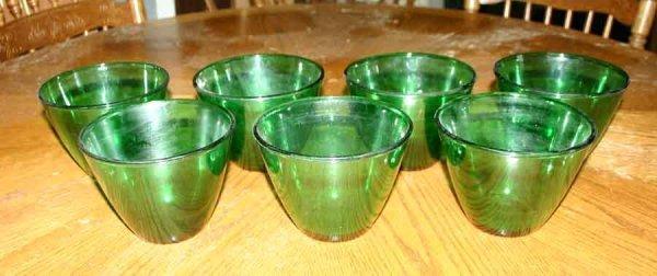 1011: Seven Green Glass Bowls