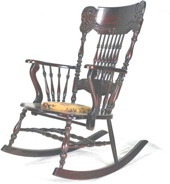 10: Carved Mahogany Spindle Rocking Chair. Circa 1900