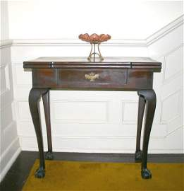 566: Georgian Mahogany Game Table. Candle corners and s