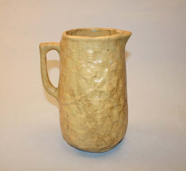 1005: Early Yellow Stoneware Pitcher. Small Chiggers.