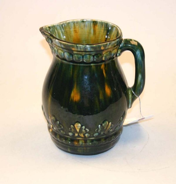 1007: High Gloss Multi-Colored Pitcher. Repair at Spout