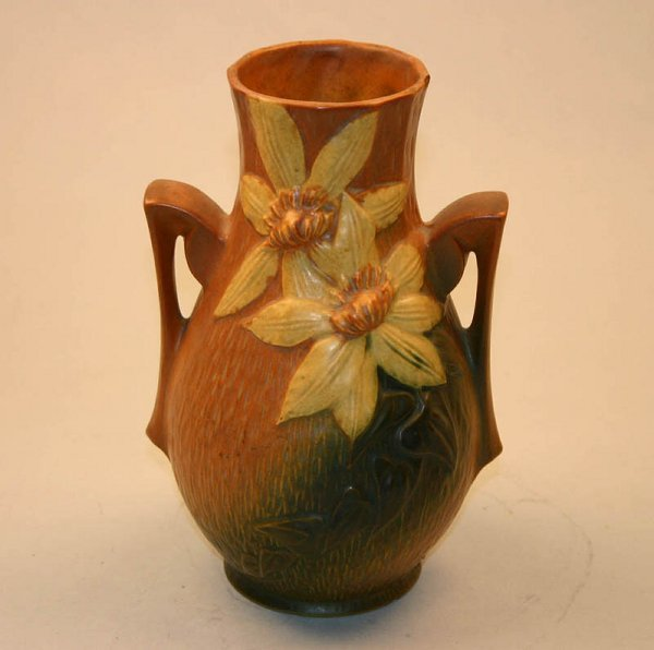1015: Roseville Clematis 108-8 Vase. Chip at Lip.
