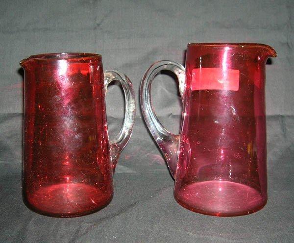 211: Pair Cranberry Glass Pitchers