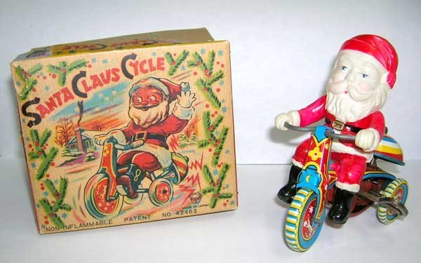 219: Working Tin Wind up Santa Claus Cycle Toy w/Origin