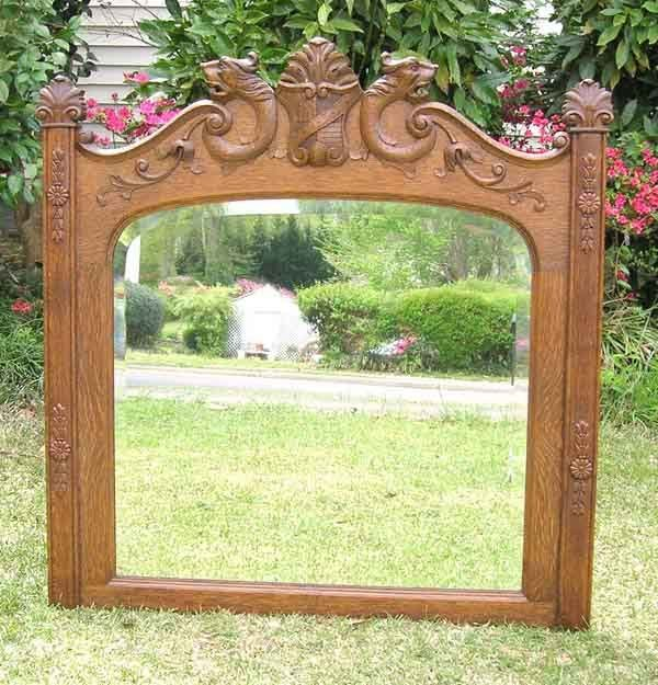 """12: Oak Wall Mirror with Carved Lion Heads. 41""""h x 40""""w"""