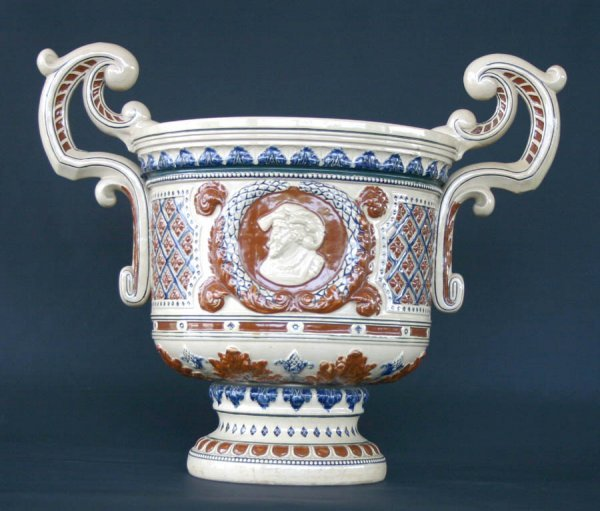 """7: Majolica Style Double Handle Urn. 17.5""""h x 20""""w"""