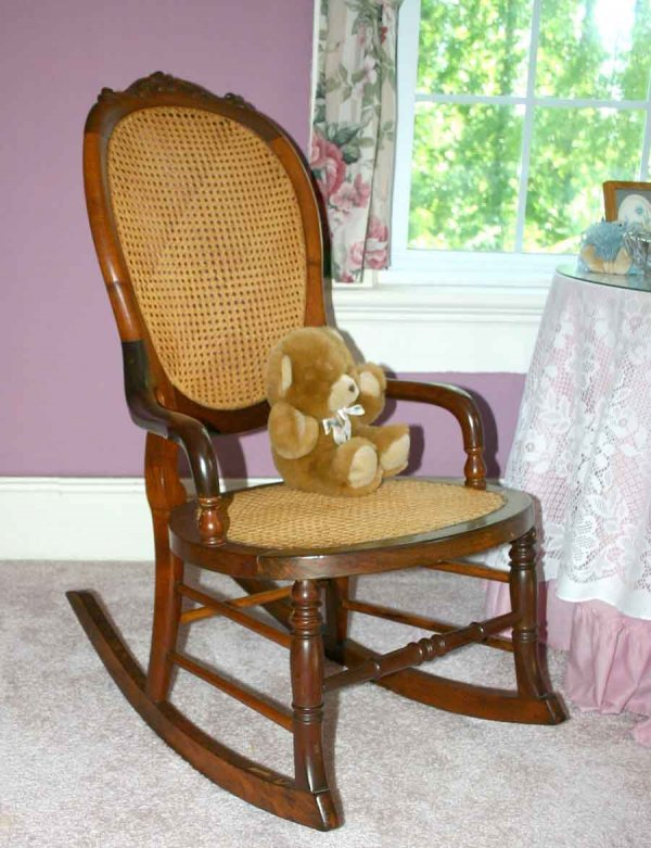 18: Victorian Balloon Back Rocking Chair with Cane Back