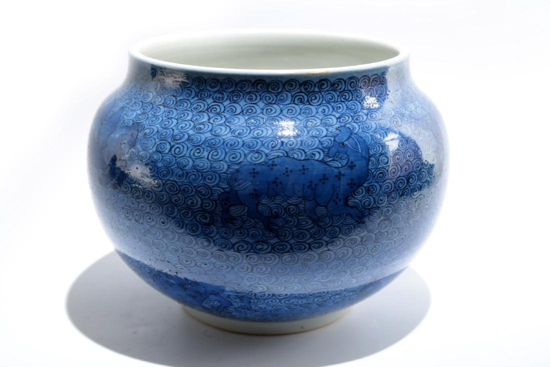 A BLUE GROUND PORCELAIN JAR WITH PATTERN OF DIVINE