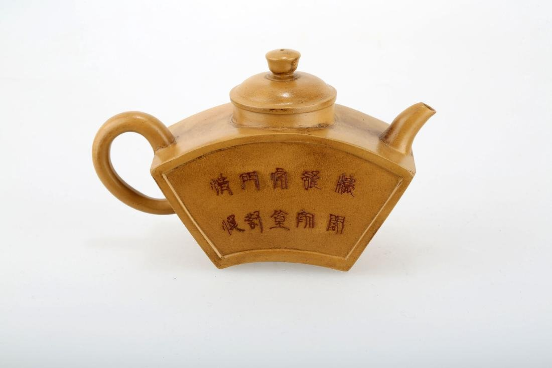 A CHINESE YIXING CLAY TEAPOT WITH BIRD, FLOWER AND