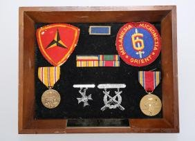 DISPLAY OF MILITARY PATCHES & MEDALS.Z031.