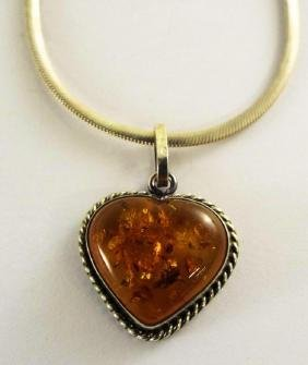 A STERLING SILVER NECKLACE WITH AMBER HEART