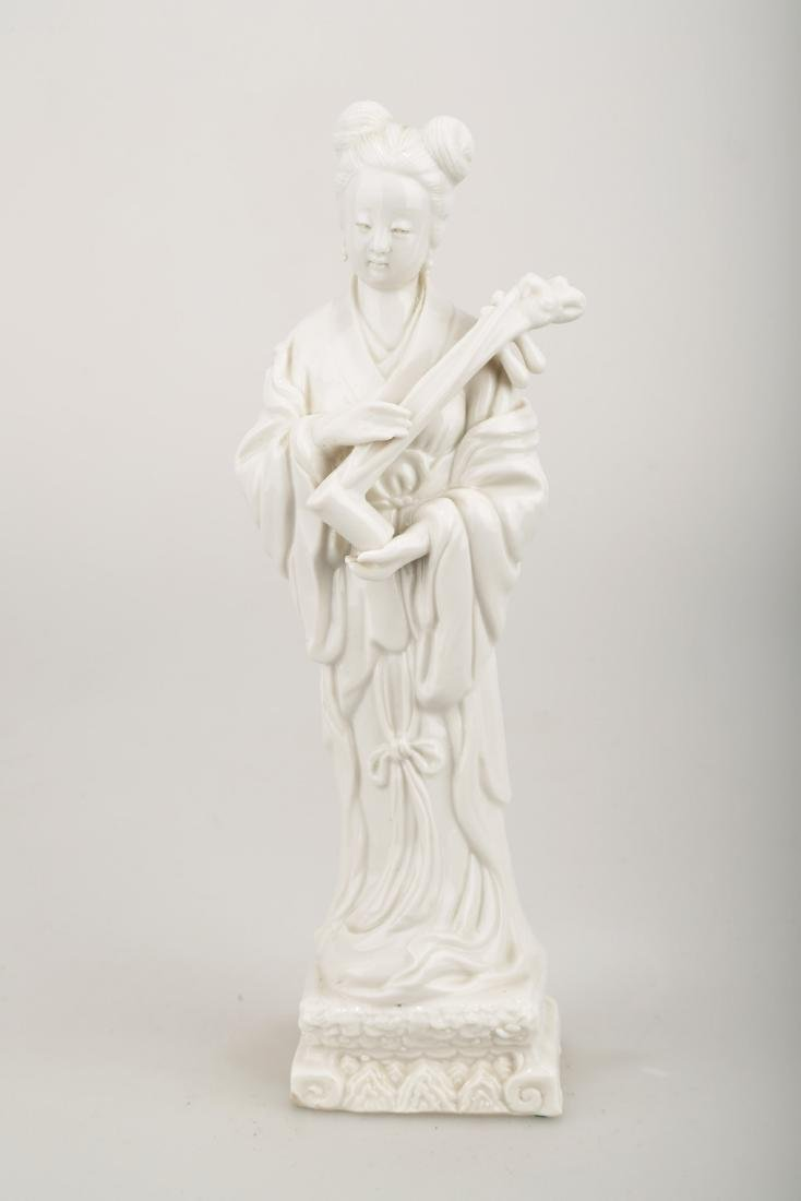 A BLANC DE PORCELAIN TRADITIONAL CHINESE LADY