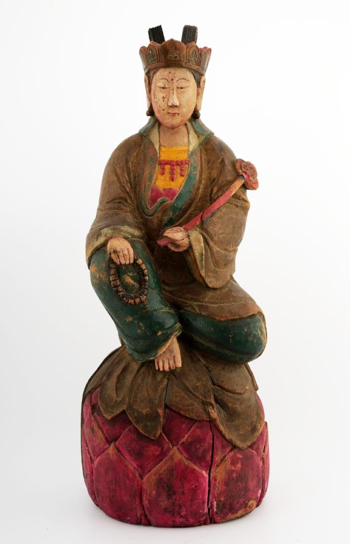 A LACQUERED WOOD FIGURE OF GUANYIN BUDDHA