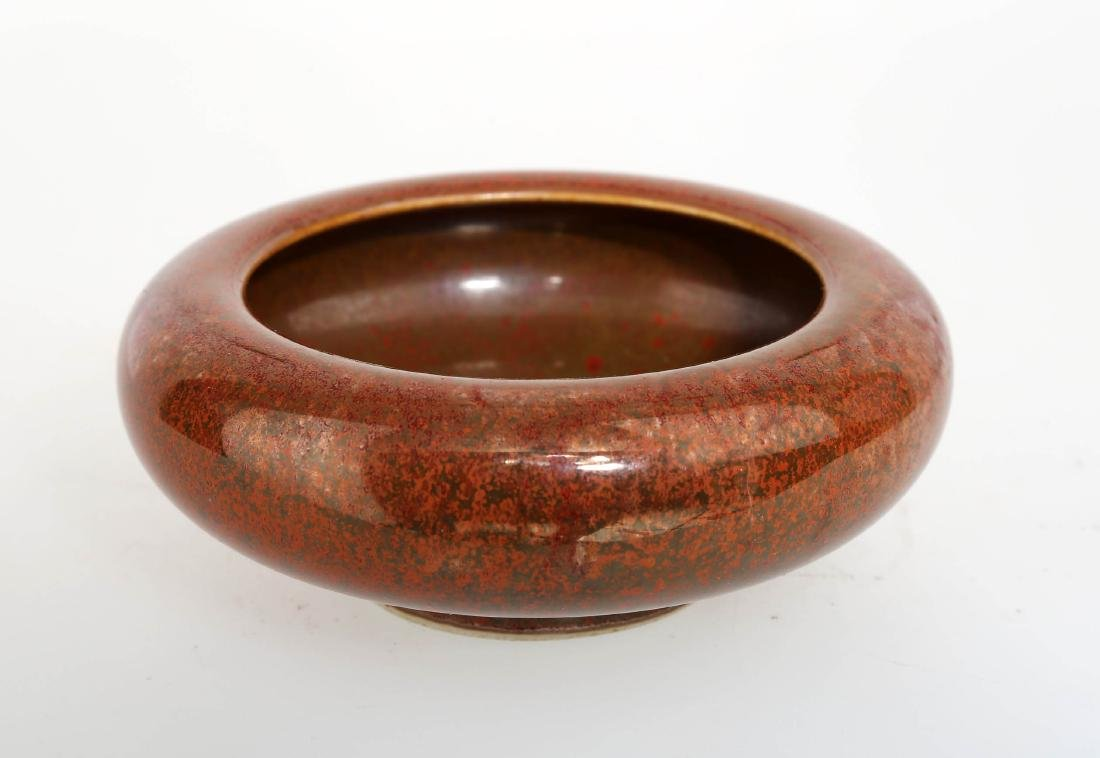 A COWPEA RED GLAZE PORCELAIN BRUSHWASHER.THE BASE