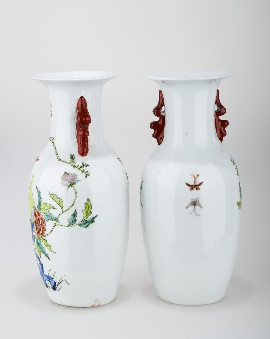 (2)  A PAIR OF FAMILLE ROSE PORCELAIN VASES. THE BASE - 2