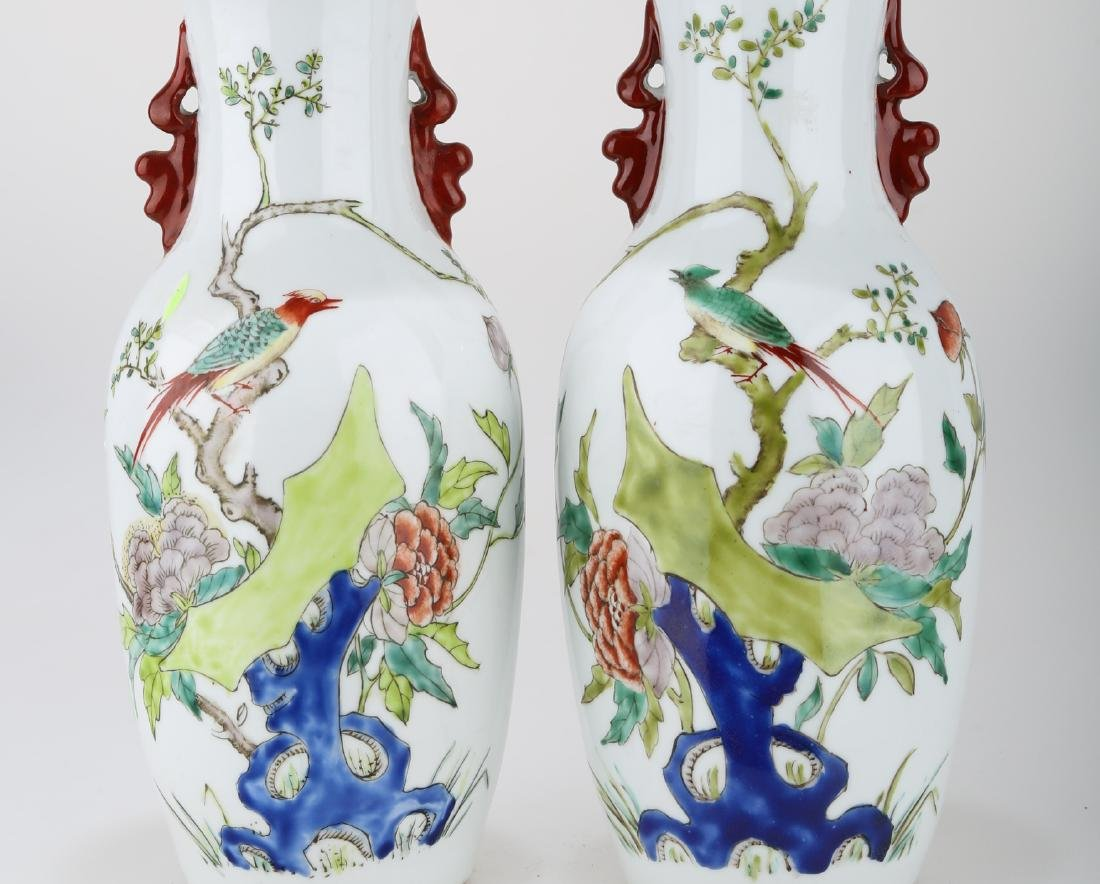 (2)  A PAIR OF FAMILLE ROSE PORCELAIN VASES. THE BASE - 3