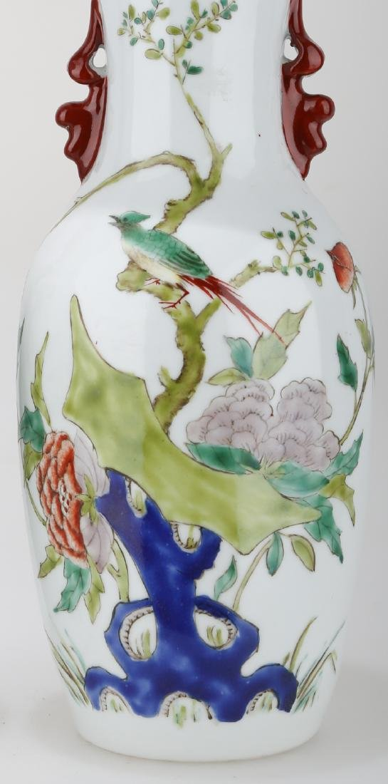 (2)  A PAIR OF FAMILLE ROSE PORCELAIN VASES. THE BASE - 7