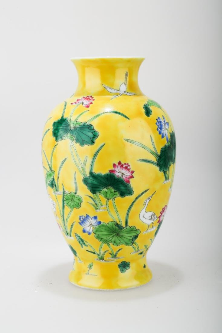 A JAUNE GROUND PORCELAIN WINE EWER WITH FLORAL AND