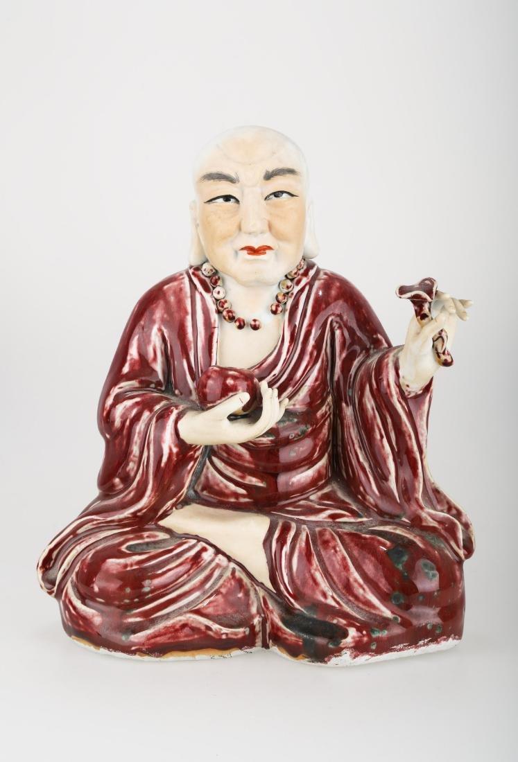 A UNDERGLAZE RED BUDDHIST FIGURE.C222.